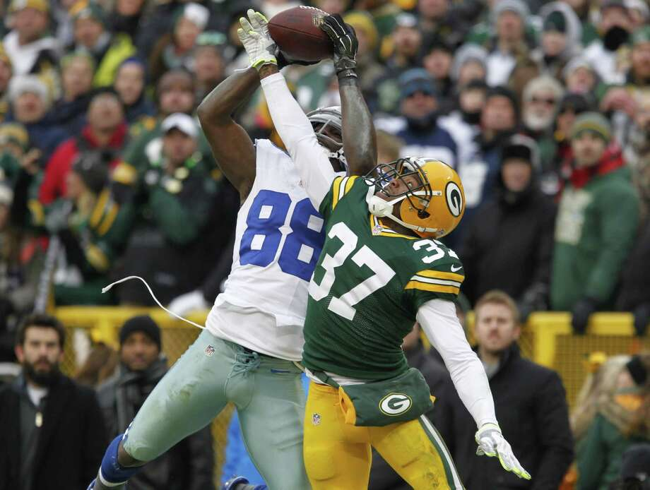 Cowboys wide receiver Dez Bryant (88) catches a pass as the Packers' Sam Shields defends during the second half Sunday. The play was reviewed and reversed by officials. Photo: Matt Ludtke — The Associated Press  / FR155580 AP