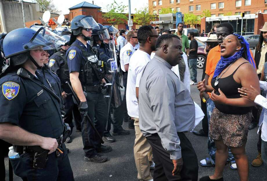 Protesters chant in front of police on May 4, 2015 in Baltimore. Photo: Amy Davis/The Baltimore Sun Via AP  / The Baltimore Sun