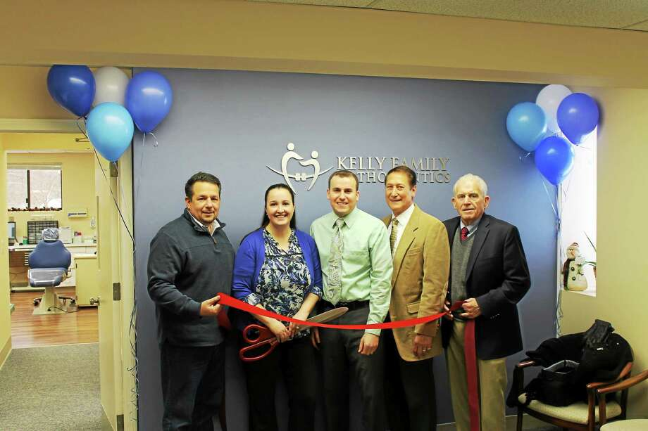 Chamber Chairman Rich Carella (far left), President Larry McHugh (far right) and Middletown Councilman Tom Serra help Gillian and Michael Kelly (center) cut the ribbon at Kelly Family Orthodontics on Jan. 9. Photo: Courtesy Middlesex County Chamber Of Commerce