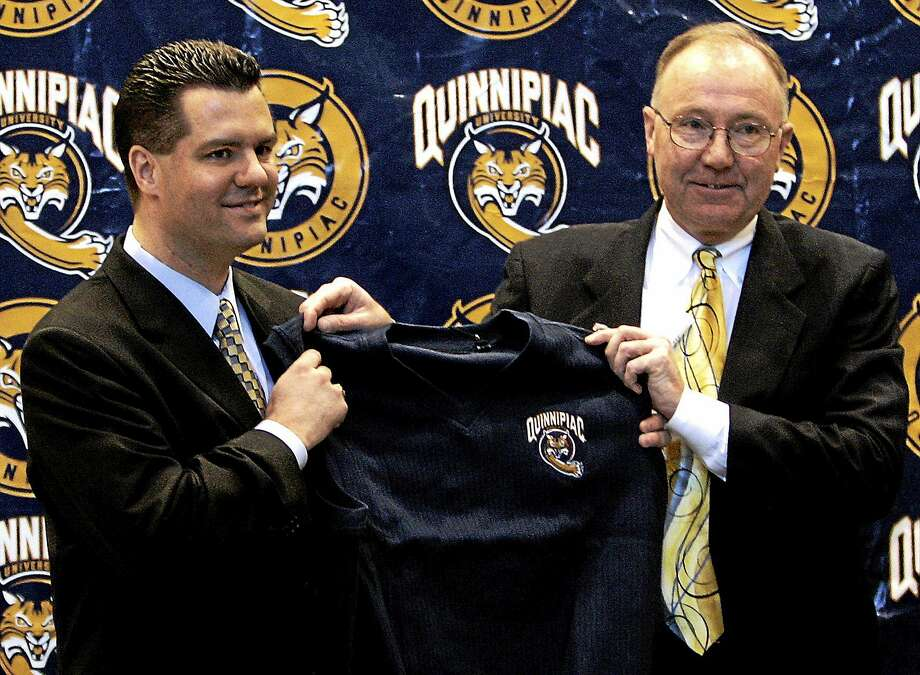 Quinnipiac AD Jack McDonald, here announcing the hiring of men's basketball coach Tom Moore, left, will not retire when he leaves the school on June 30. He will become associate vice president and director of athletics at the University of New England in Biddleford, Maine. Photo: Bob Child — The Associated Press File Photo  / AP