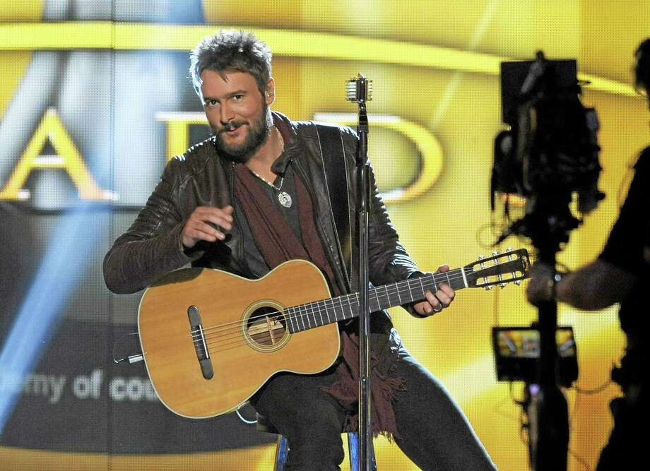 In this April 7, 2013 photo, singer Eric Church performs at the 48th Annual Academy of Country Music Awards at the MGM Grand Garden Arena in Las Vegas. Photo: Photo By Chris Pizzello/Invision/AP, File  / Invision