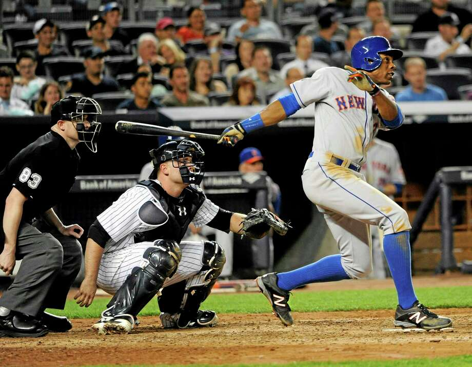 The Mets' Curtis Granderson hits a two-run home run in the sixth inning Monday at Yankee Stadium. Photo: Kathy Kmonicek — The Associated Press  / FR170189 AP