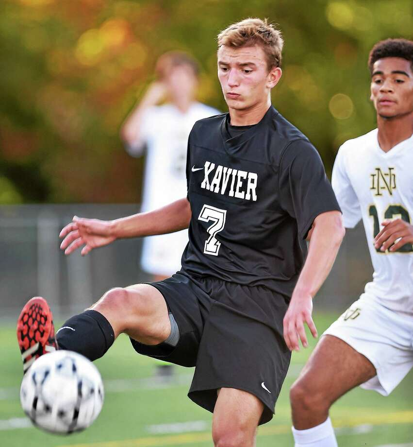 Xavier senior Joey Zacchia looks to generate some offense against Notre Dame-West Haven last season. Photo: Catherine Avalone — New Haven Register  / The Middletown Press