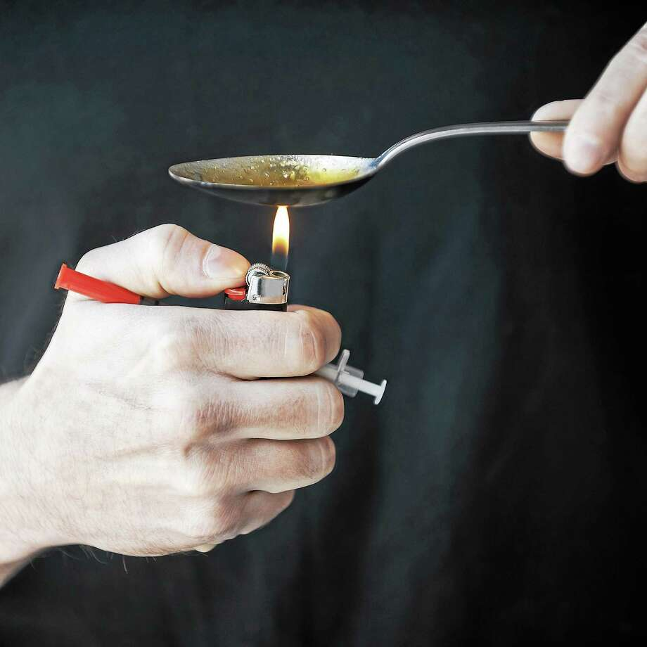 Man boiling heroin. Photo: Getty Images/iStockphoto / iStockphoto