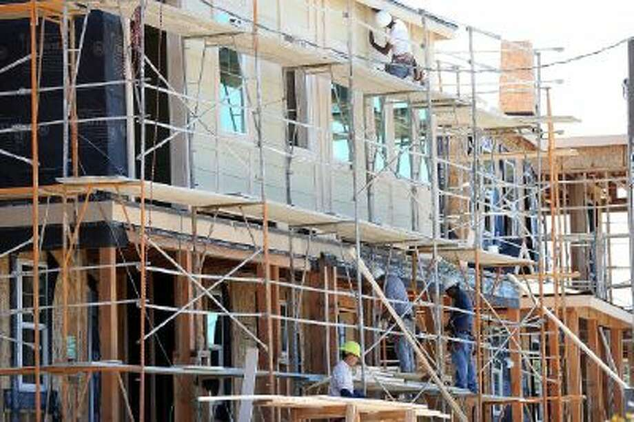 A construction crew works on the exterior of a new home in Petaluma, California.