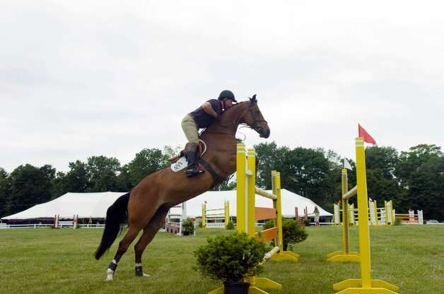 Stamford's Peter Leone works toward his win of the $5,000 Welcome class at the 80th Ox Ridge June Show June 16, 2010. The show runs through Sunday. Photo: Keelin Daly / Stamford Advocate