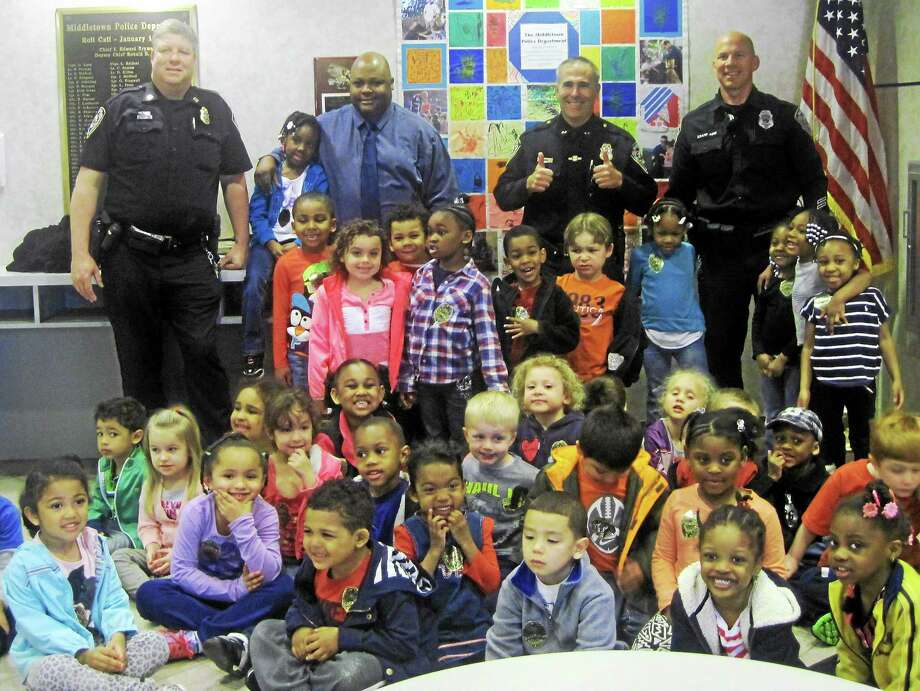 Submitted photo The culmination of the YMCAís recent Week of the Young Child observances was the presentation of an honorary quilt crafted by preschoolers to the Middletown police department. Photo: Journal Register Co.
