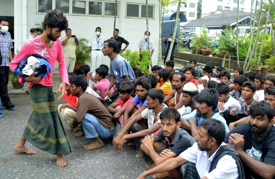 Illegal immigrants from Myanmar and Bangladesh arrive at the Langkawi police station's multi purpose hall in Langkawi, Malaysia on May 11, 2015. Hundreds of migrants abandoned at sea by smugglers in Southeast Asia have reached land and relative safety in the past two days. Photo: AP Photo/Hamzah Osman  / AP
