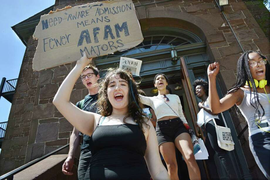 Wesleyan University students exit the president's office at College Row in protest of the possibility of deep cuts in the African American Studies program Monday afternoon. Photo: Catherine Avalone — The Middletown Press