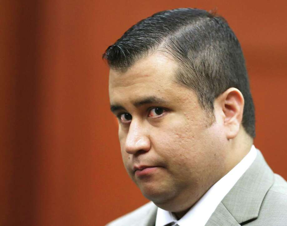 FILE - In this July 9, 2013, file photo, George Zimmerman leaves the courtroom for a lunch break his trial in Seminole Circuit Court, in Sanford, Fla. Photo: (Joe Burbank/Orlando Sentinel Via AP, Pool, File) / Pool Orlando Sentinel