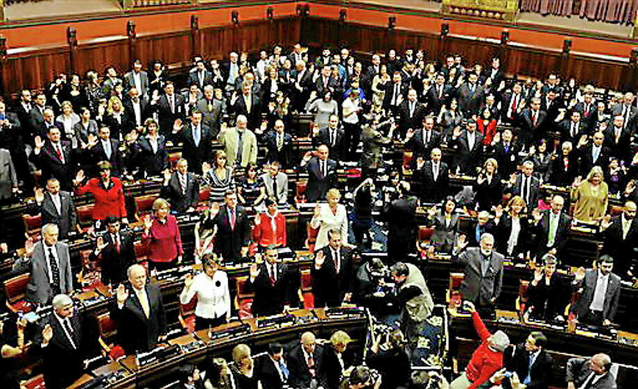 In this file photo, members of the Connecticut House of Representatives are being sworn in at the Capitol in Hartford in 2013. Photo: (AP File Photo/Jessica Hill) / FR125654 AP