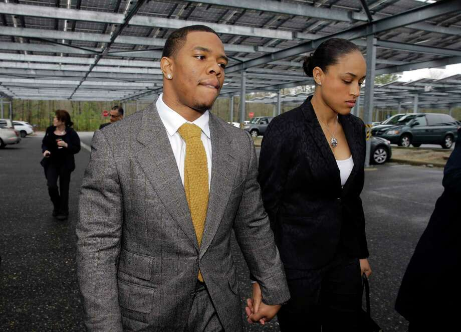 """FILE - In this May 1, 2014, file photo, Baltimore Ravens football player  Ray Rice holds hands with his wife, Janay Palmer, as they arrive at Atlantic County Criminal Courthouse in Mays Landing, N.J. Banter by two """"Fox & Friends"""" hosts about video showing Rice hitting his then future wife is under fire. The hosts, Brian Kilmeade and Steve Doocey, made their on-air comments Monday, Sept. 8, 2014, while discussing newly released elevator video showing Rice hitting Janay Palmer in February. Photo: (AP Photo/Mel Evans, File) / AP"""