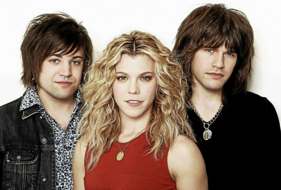 """Photo by Matt Sayles/Invision/AP Musicians Kimberly Perry, center, Neil Perry, left, and Reid Perry, from The Band Perry in Los Angeles. The band released its sophomore album """"Pioneer"""" in April. Photo: Matt Sayles/Invision/AP / Invision"""
