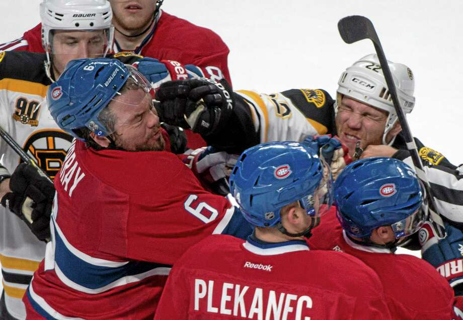 The Canadiens' Douglas Murray, left, and the Bruins' Shawn Thornton exchange blows during Game 3 of their playoff series. Photo: Paul Chiasson — The Associated Press  / The Canadian Press