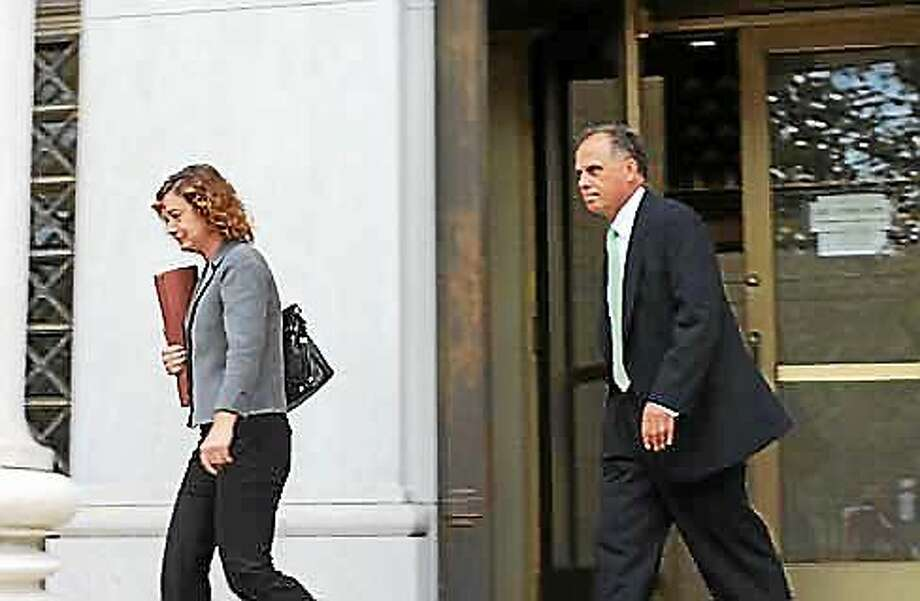 Brian Foley and his attorney Jessica Santos leave the federal courthouse in New Haven. Photo: Christine Stuart — CT News Junkie