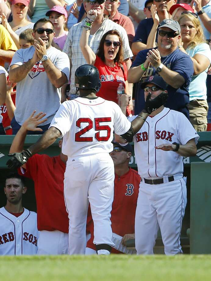 Fans cheer as Red Sox outfielder Jackie Bradley Jr. (25) is congratulated by interim manager Torey Lovullo after hitting a two-run home run against the Toronto Blue Jays Monday at Fenway Park in Boston. Photo: Winslow Townson — The Associated Press  / FR170221 AP