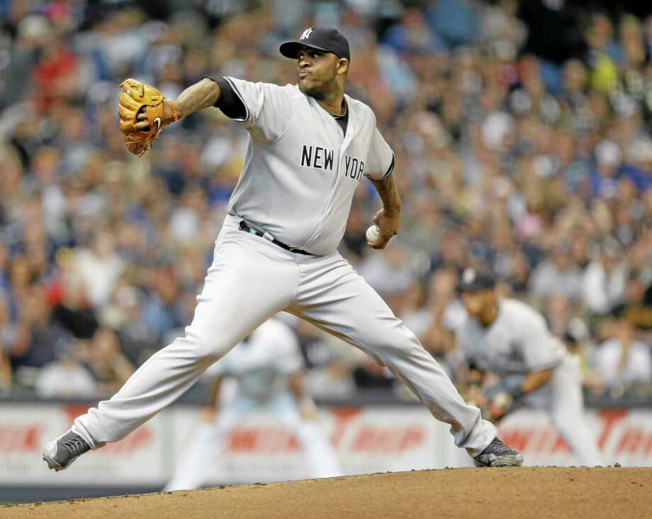 2New York Yankees starting pitcher CC Sabathia throws to the Milwaukee Brewers in the first inning of a baseball game Saturday, May 10, 2014, in Milwaukee. (AP Photo/Jeffrey Phelps) Photo: AP / FR59249 AP