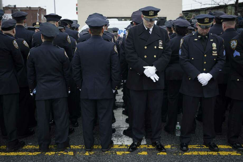 Some police officers turn their backs in sign of disrespect as Mayor Bill de Blasio speaks during the funeral of New York Police Department Officer Wenjian Liu at Aievoli Funeral Home on Sunday in the Brooklyn borough of New York. Photo: AP File Photo  / FR170537 AP