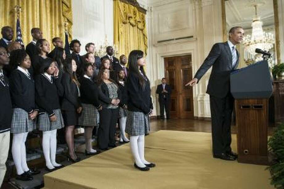President Obama announces his initiative to fight poverty at the White House with students from a Harlem school. Photo: AFP/Getty Images / 2014 AFP