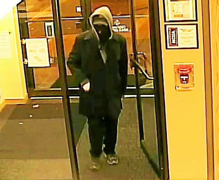 Police say a masked man robbed the Seasons Federal Credit Union in Cromwell Thursday evening while wielding a gun. He got away with an unknown amount of cash. Photo: Courtesy Cromwell Police