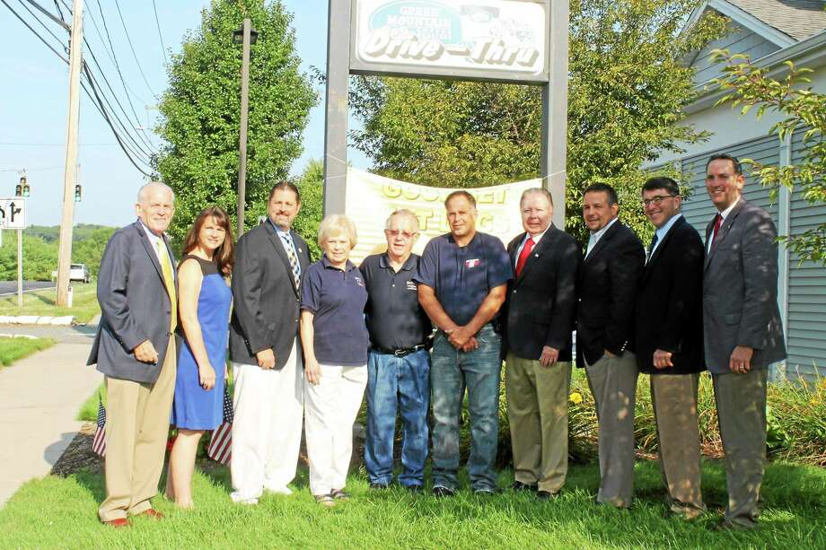 From left are Chamber President Larry McHugh, state. Rep. Christie Carpino, Cromwell Mayor Enzo Faienza, Sharon Bishop, Richard Bishop, Bill Bishop, Cromwell Division Chairman Jay Polke, Chairman Rich Carella, Cromwell Town Planner Stuart Popper and state Sen. Paul Doyle. Photo: Submitted Photo