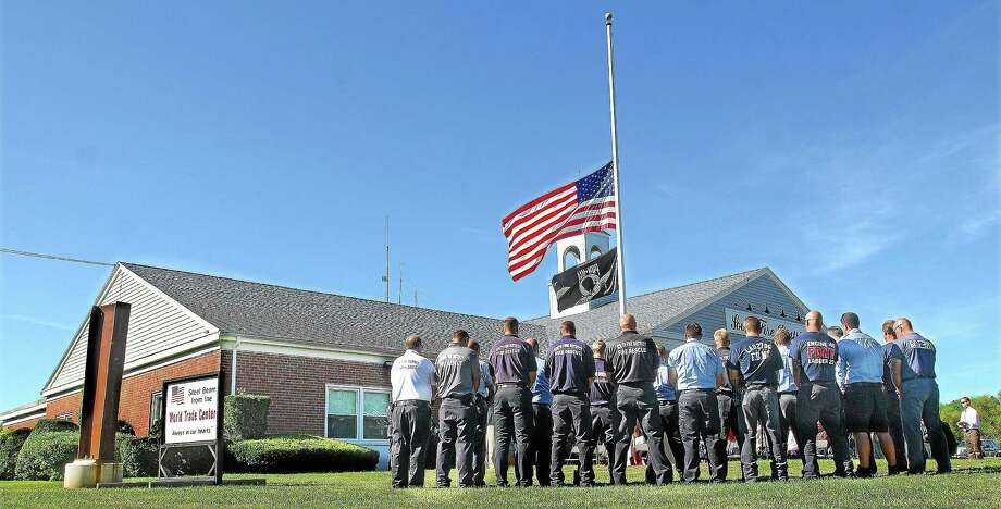 Firefighters of South District Fire in Middletown will again host a remembrance ceremony to honor the victims of the World Trade Center attacks. The ceremony starts at 8:30 a.m. on Friday at the firehouse. Photo: Middletown Press File Photo