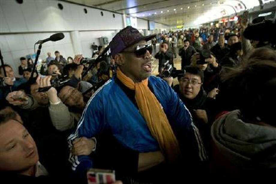 Former NBA basketball player Dennis Rodman is followed by journalists Jan. 13 as he arrives at the Capital International Airport in Beijing from Pyongyang. Photo: AP / AP