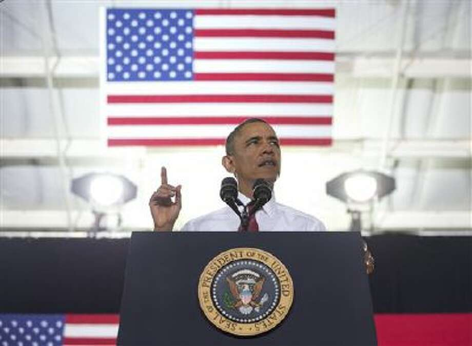 President Barack Obama speaks about the economy, jobs, and manufacturing at North Carolina State University Photo: AP / AP