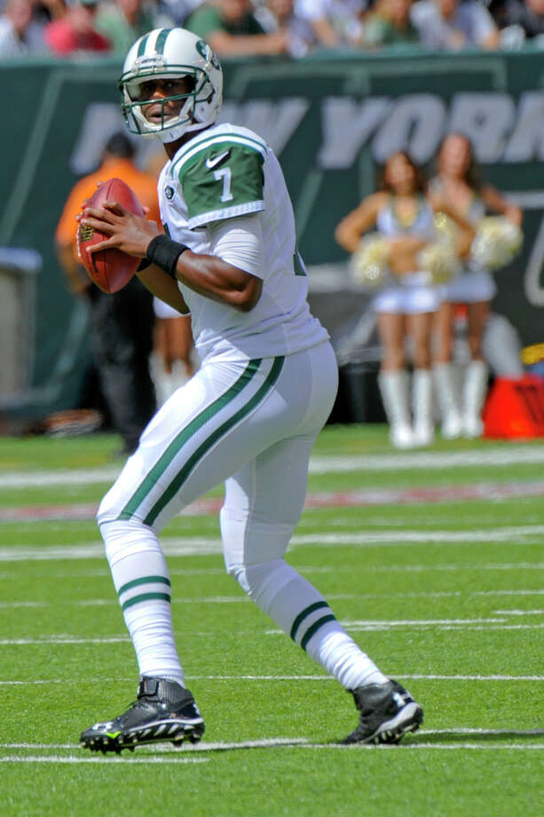 New York Jets' Geno Smith looks to pass during the first half of an NFL football game against the Oakland Raiders Sunday, Sept. 7, 2014, in East Rutherford, N.J. (AP Photo/Bill Kostroun) Photo: The Associated Press  / FR51951 AP