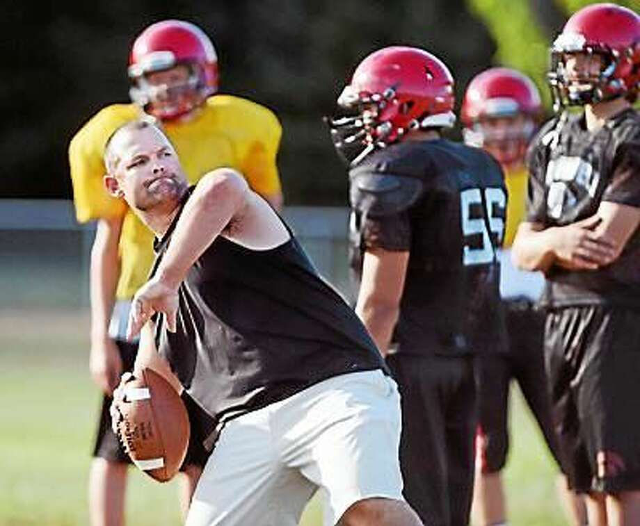 Cromwell/Portland's head coach Chris Eckert, shown in practice last year, has been placed on administrative leave as the school investigates allegations of hazing. Photo: Catherine Avalone - New Haven Register