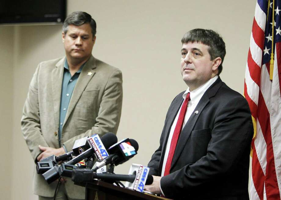 Columbia County State Attorney Jeff Seigmeister speaks during a press conference on Wednesday, Jan. 7, 2015 in Lake City, Fla. about two Columbia County girls accused of killing their brother. Columbia County Sheriff Mark Hunter, left, also spoke. (AP Photo/Matt Stamey, The Gainesville Sun) Photo: AP / The Gainsville Sun