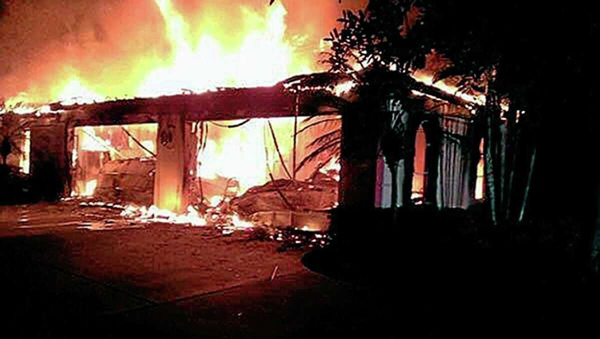 In this photo provided by the Hillsborough County Sheriff's Office, flames destroy a mansion owned by former tennis star James Blake, who grew up in Fairfield, on Wednesday in a gated community in Tampa, Fla.