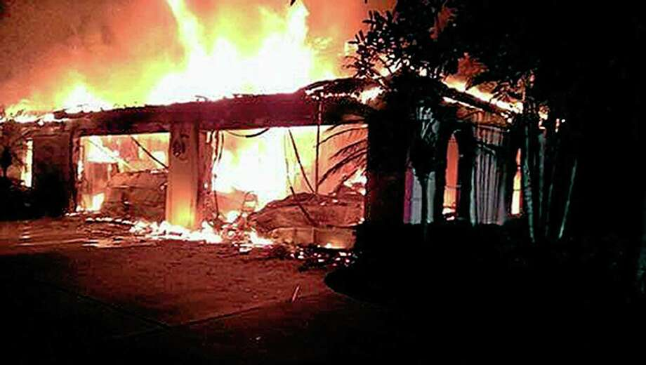 In this photo provided by the Hillsborough County Sheriff's Office, flames destroy a mansion owned by former tennis star James Blake, who grew up in Fairfield, on Wednesday in a gated community in Tampa, Fla. Photo: Hillsborough County Sheriff's Office — The Associated Press  / Hillsborough County Sheriff