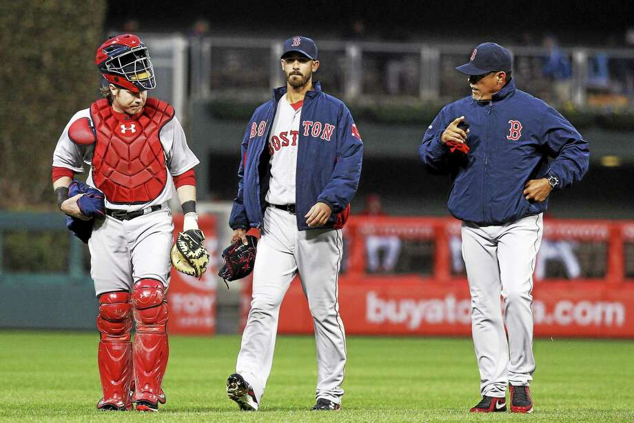 The Boston Red Sox fired pitching coach Juan Nieves, right, on Thursday. Photo: Chris Szagola — The Associated Press File Photo  / FR170982 AP