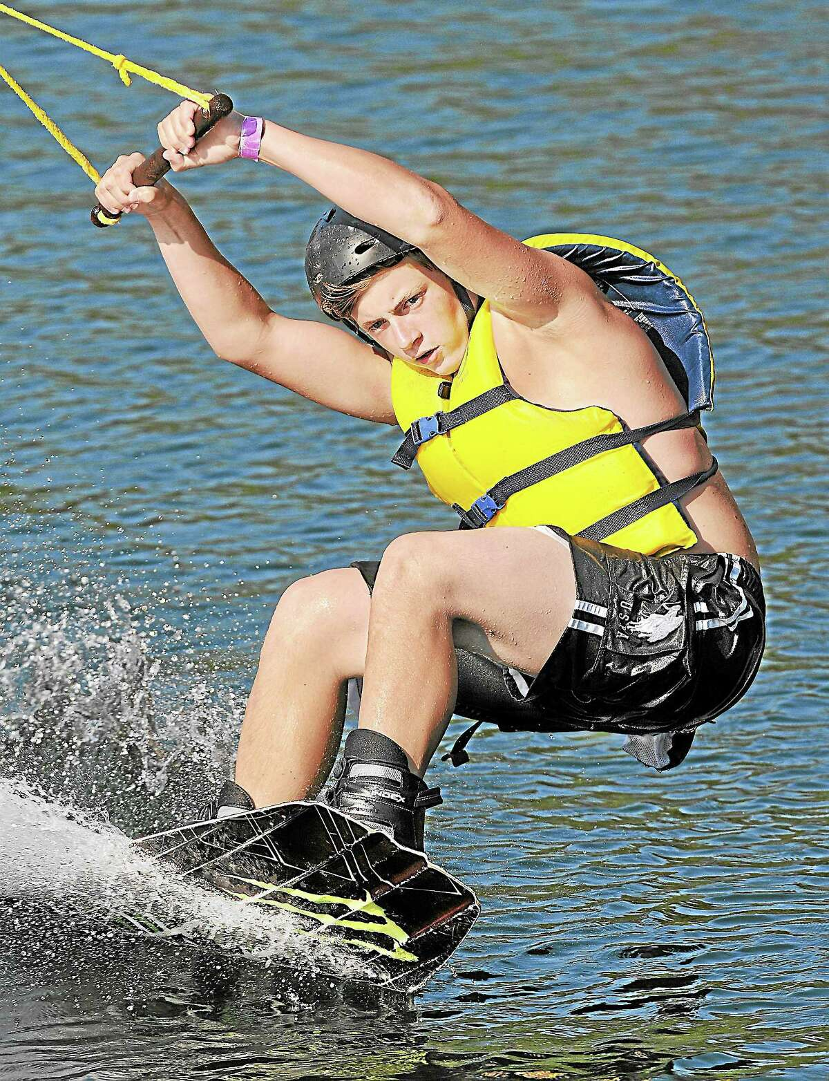 Jordan Ballard, of Suffield, wakeboards at Brownstone Exploration and Discovery Park.