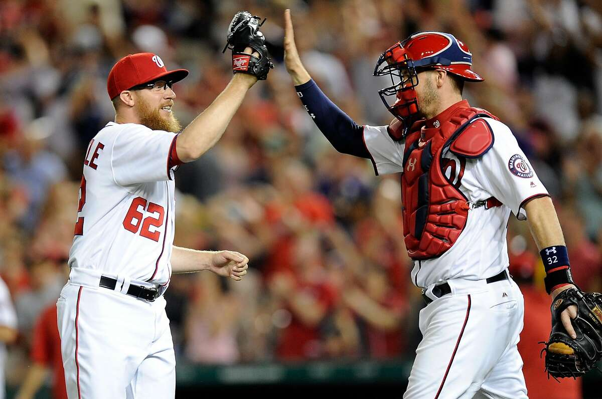WASHINGTON, DC - AUGUST 10: Sean Doolittle #62 of the Washington Nationals celebrates with Matt Wieters #32 after a 3-2 victory against the Miami Marlins at Nationals Park on August 10, 2017 in Washington, DC. (Photo by Greg Fiume/Getty Images)