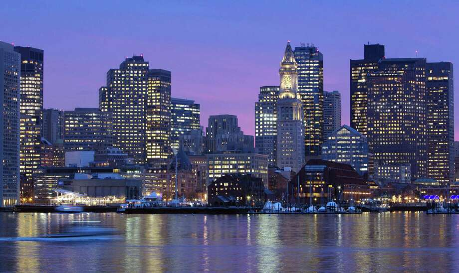 FILE - In this Jan. 6, 2012 file photo, the Boston city skyline is illuminated at dusk as it reflects off the waters of Boston Harbor. When the leaders of the U.S. Olympic Committee meet Thursday, Jan. 8, 2015, they'll be deciding on more than a city to put in the running to host the 2024 Summer Games. Photo: (AP Photo/Michael Dwyer, File) / AP