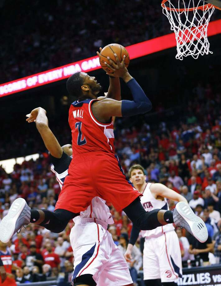 Washington Wizards guard John Wall has multiple fractures in his wrist and hand. Photo: John Bazemore — The Associated Press  / AP