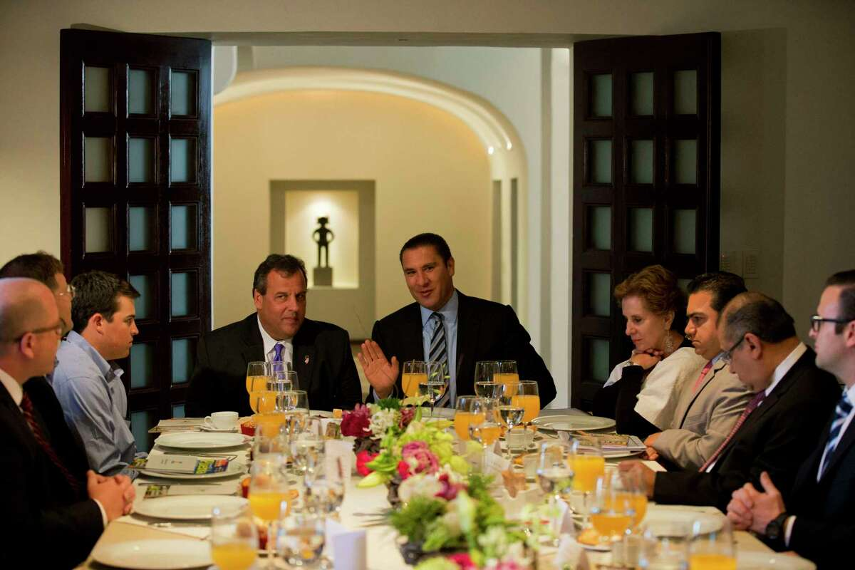 New Jersey Gov. Chris Christie, center left, talks with Puebla Gov. Rafael Moreno Valle, center right, during breakfast at the governor's residence in Puebla, Mexico, Friday, Sept. 5, 2014. The potential 2016 contender has called his three-day trade mission to Mexico a learning opportunity.(AP Photo/Rebecca Blackwell)
