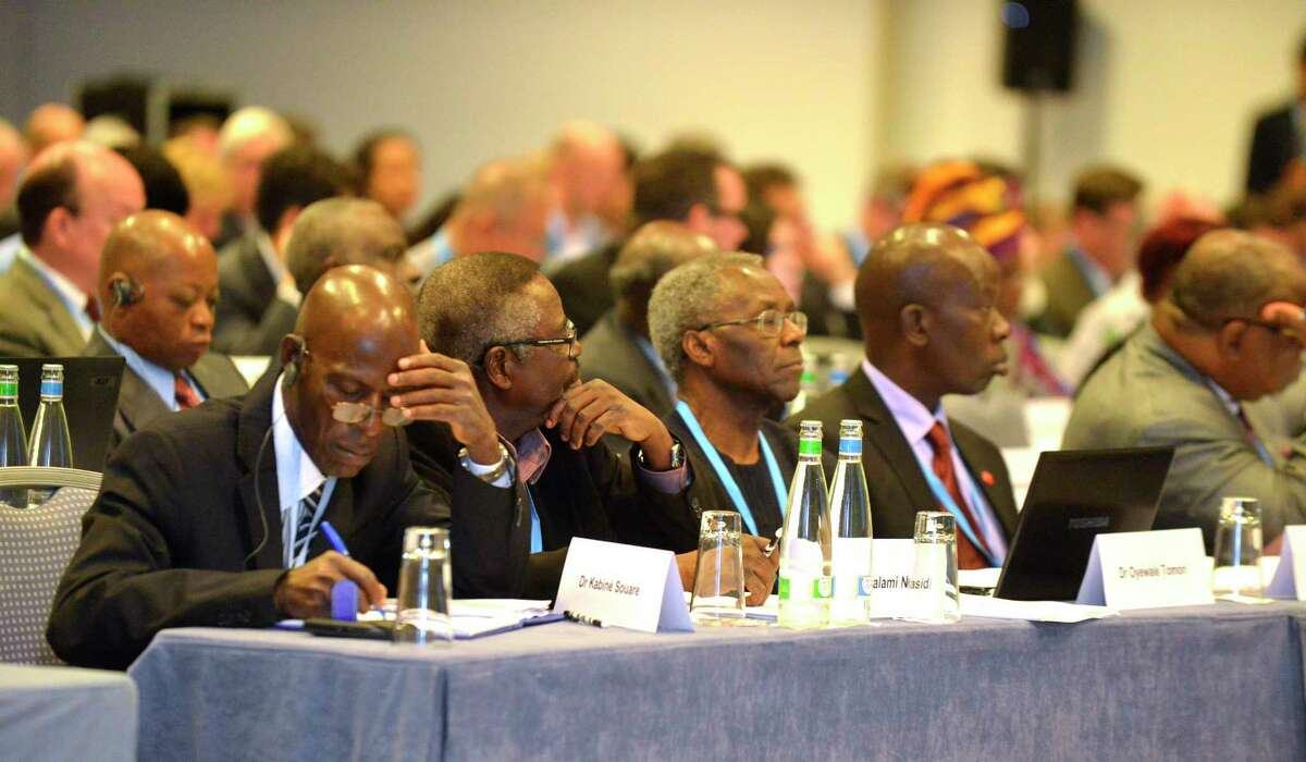 Participants of the WHO conference listen to speeches on therapies and vaccines with potential to treat or prevent Ebola virus disease, in Geneva, Switzerland, Thursday, Sept. 4, 2014. (AP Photo/Keystone,Christian Brun)