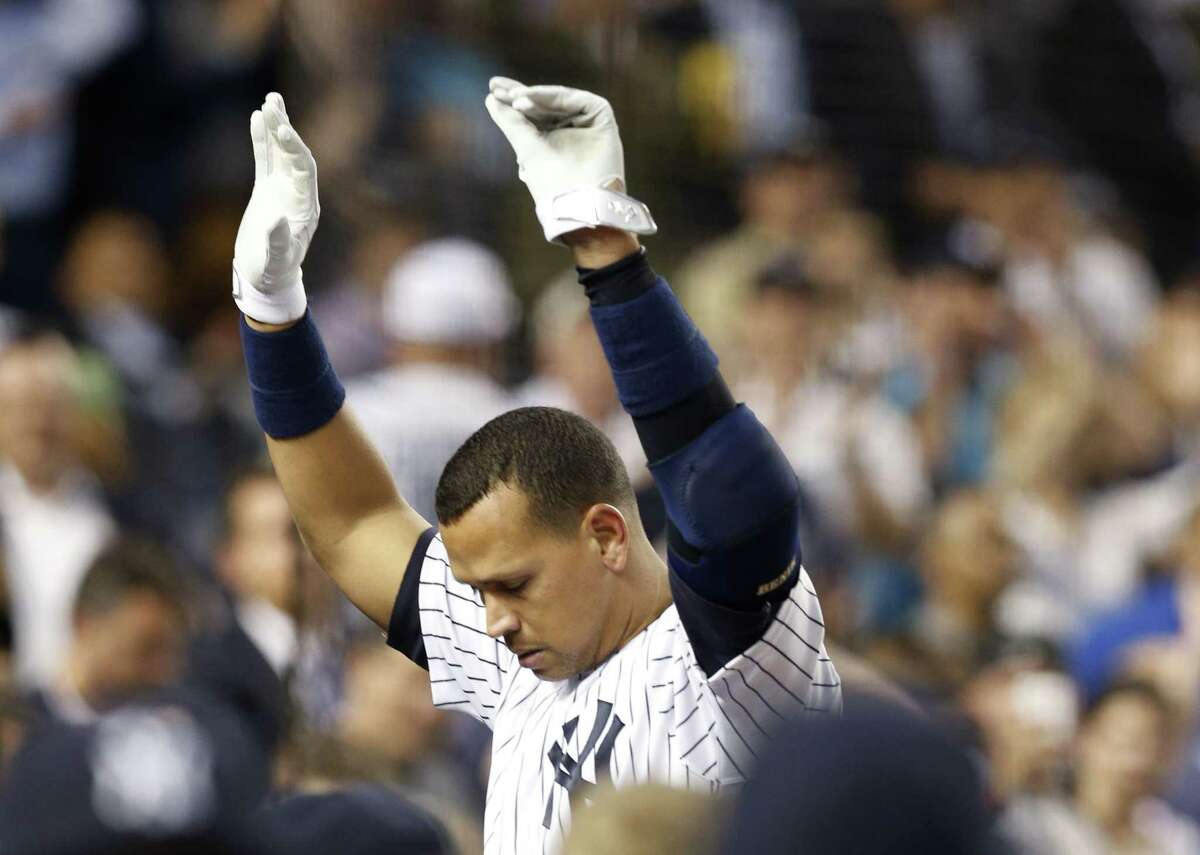 Yankees designated hitter Alex Rodriguez takes a curtain call after hitting his 661st home run and surpassing Willie Mays on the all-time home run list Thursday.
