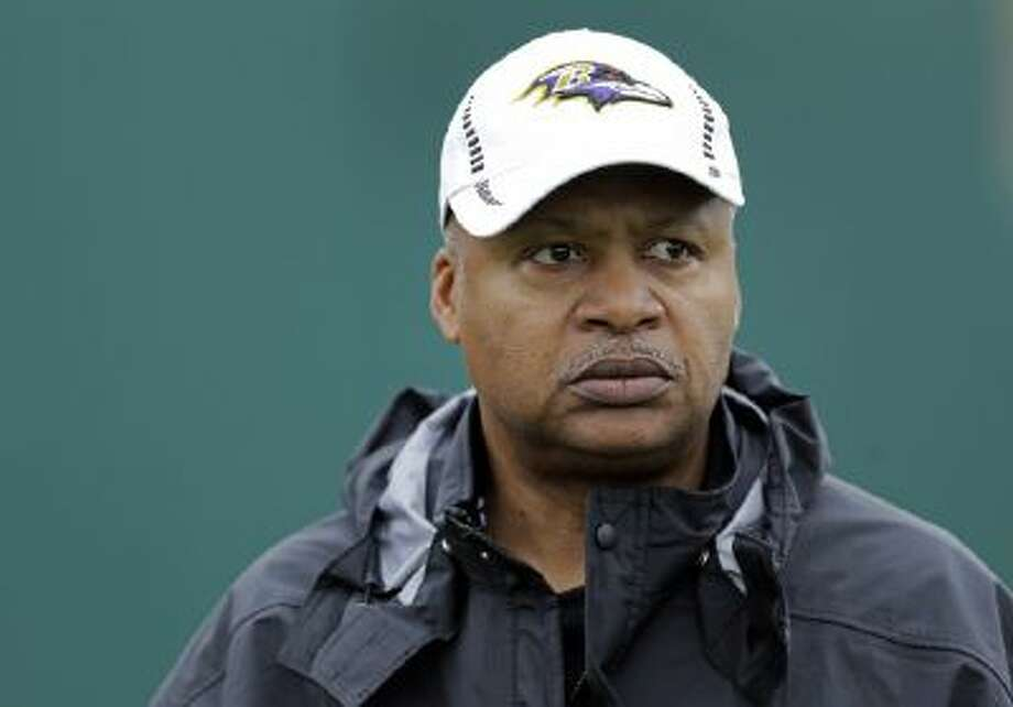 In this Jan. 30, 2013, file photo, Baltimore Ravens offensive coordinator Jim Caldwell walks onto the field as his team warms up during an NFL Super Bowl XLVII practice in New Orleans.
