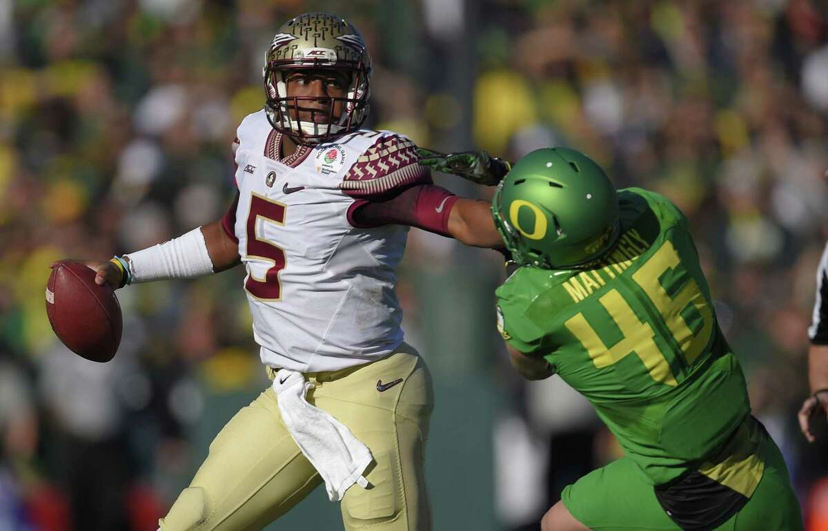 Florida State quarterback Jameis Winston, left, looks to pass under pressure from Oregon linebacker Danny Mattingly during the first half of the Rose Bowl on Jan. 1 in Pasadena, Calif.
