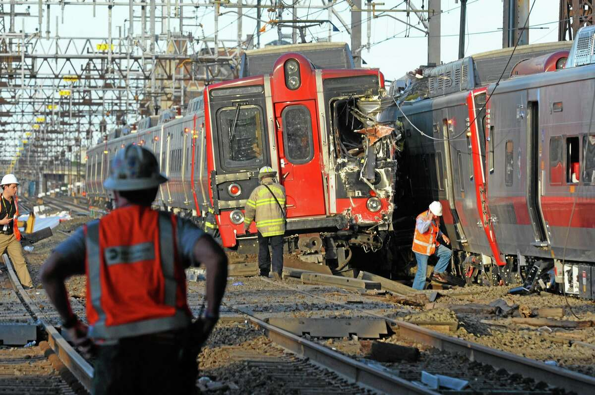 Emergency personnel work at the scene where two Metro-North commuter trains collided on May 17, 2013. William Kaempffer, a spokesman for Bridgeport public safety, told The Associated Press approximately 49 people were injured, including four with serious injuries. About 250 people were on board the two trains, he said.