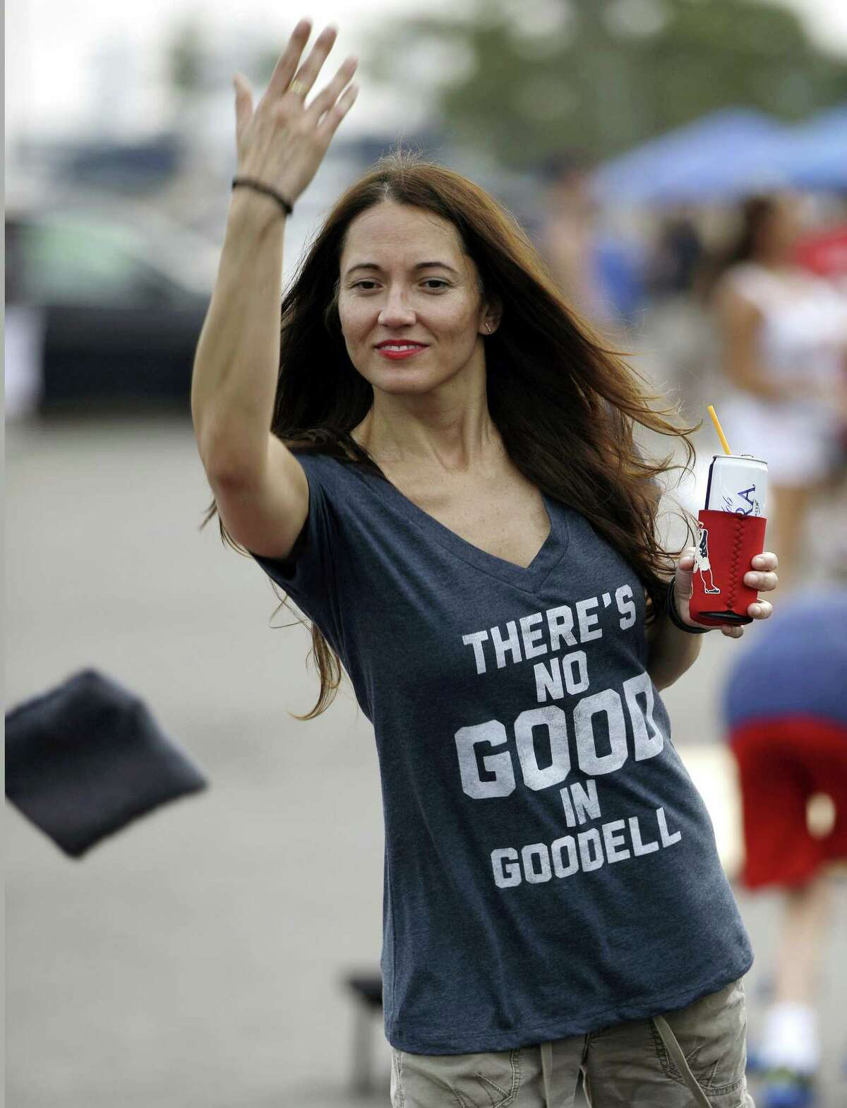 New England Patriots fan Karen Gutierrez wears a shirt that refers to NFL Commissioner Roger Goodell as she plays a bean bag game in the parking lot of Gillette Stadium before the Pats' preseason game against the New York Giants on Thursday in Foxborough, Mass.