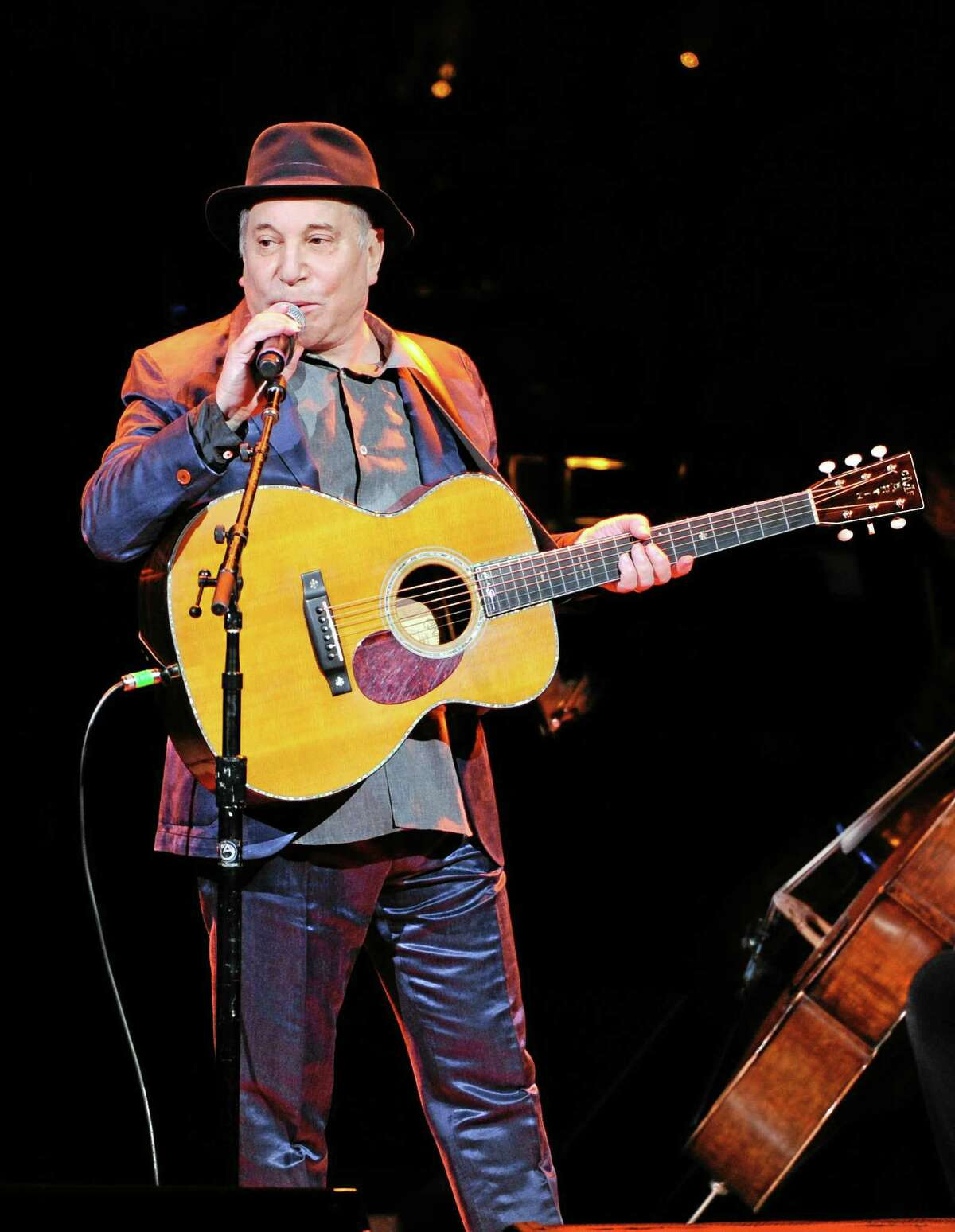 FILE - In this Thursday, April 17, 2014, file photo, musician Paul Simon performs at the 25th Anniversary Rainforest Fund benefit concert at Carnegie Hall in New York. Simon performed more than a dozen songs Wednesday night, May 7, 2014, at the Beacon Theatre in New York, where he was honored at the 2014 NYU Steinhardt Vision Award Gala. It was Simon's first public appearance since he and wife Edie Brickell were arrested on disorderly conduct charges. (Photo by Evan Agostini/Invision/AP, File)