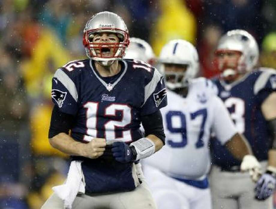 Brady celebrates a touchdown by New England Patriots running back LeGarrette Blount.