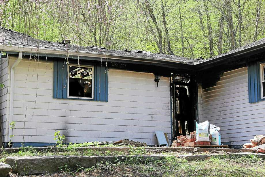 A home on Route 151 in East Hampton was consumed in a fierce morning blaze Thursday. Photo: Middletown Press Staff  / Kathleen Schassler All Rights