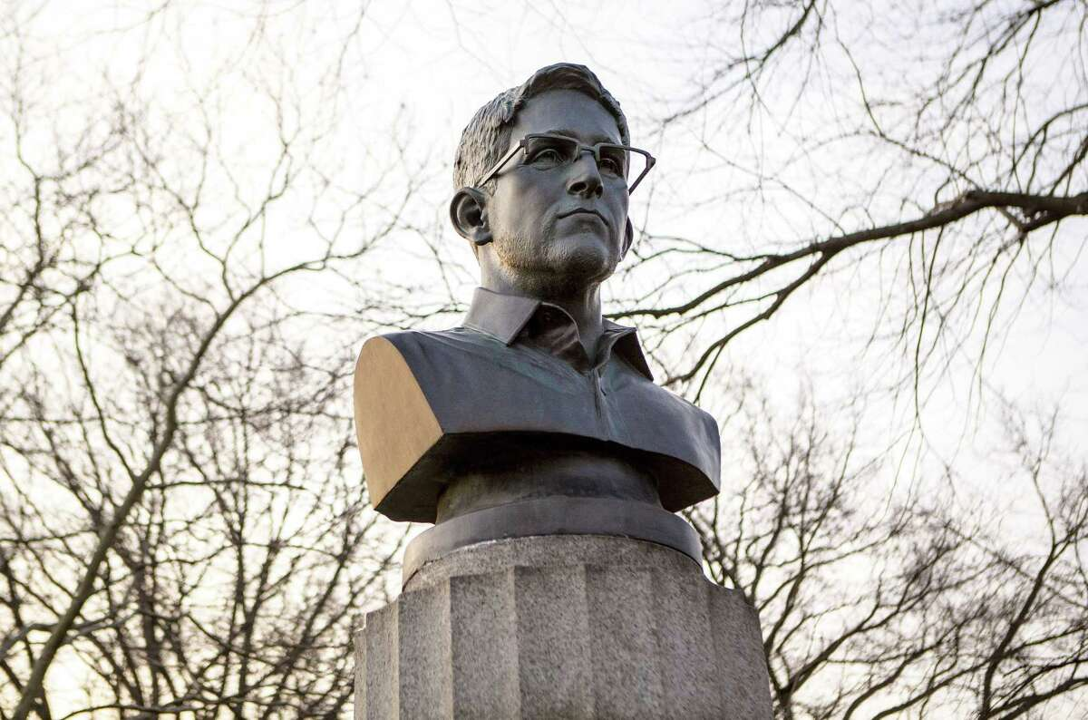 FILE - This April 6, 2015, file photo provided by ANIMALNewYork shows a bust of the former National Security Agency contractor Edward Snowden which was snuck overnight into Brooklyn's Fort Greene Park, in New York. Attorney Ronald Kuby, the lawyer for the mystery artists who affixed the bust of Edward Snowden to the New York park's war monument, says they've been ticketed but not criminally charged. Kuby says the three got summonses for being in a park after hours, a non-criminal violation.