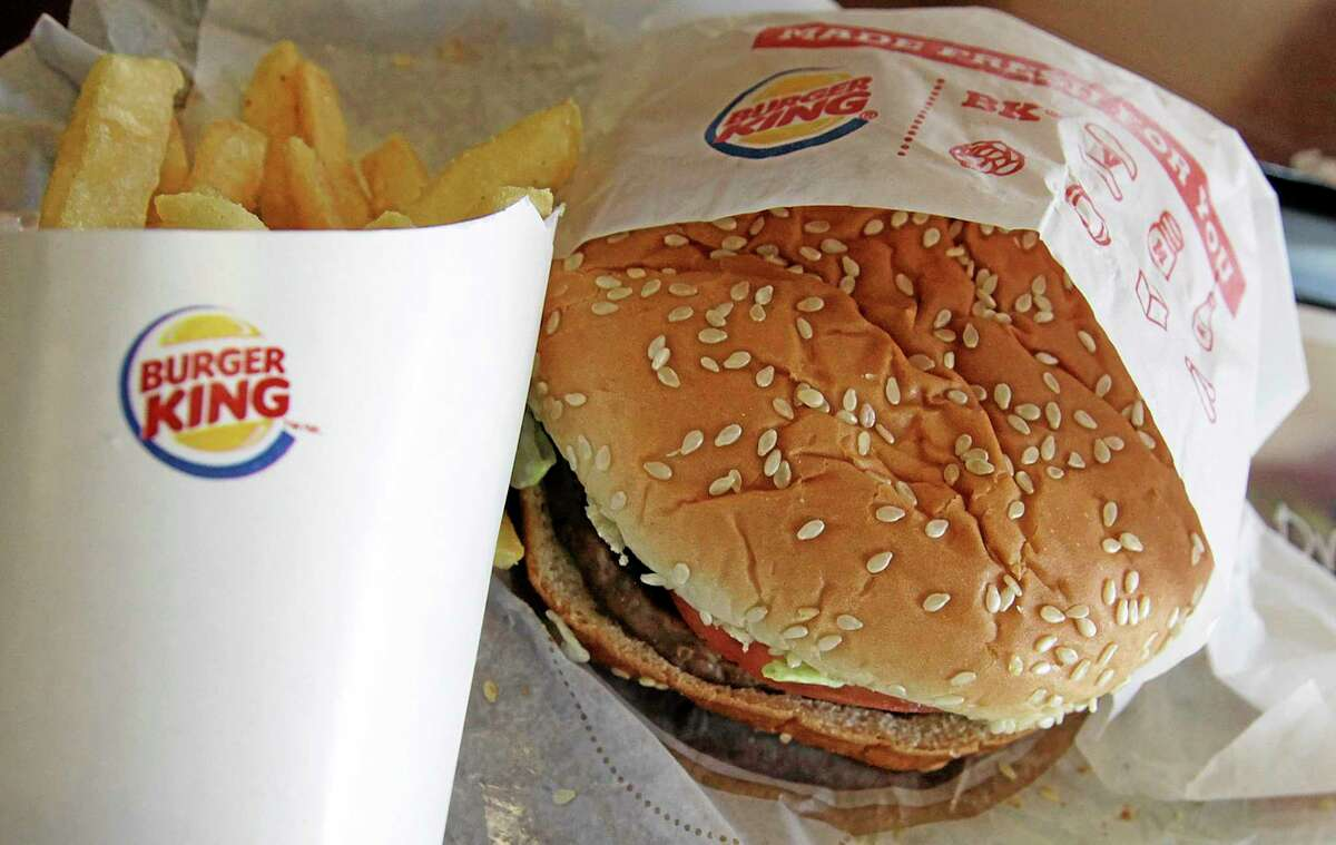 """FILE - This Wednesday, June 20, 2012 file photo shows a burger and fries at a Burger King in Richardson, Texas. The Miami-based chain on Thursday, May 8, 2014 announced it is offering """"Burgers for Breakfast,"""" which include its Whoppers, Cheeseburgers and Big King sandwiches, as well as its Original Chicken Sandwich, french fries and apple pie. (AP Photo/LM Otero, File)"""